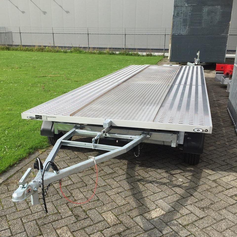 Elektrische geremde schamelwagens en opleggers